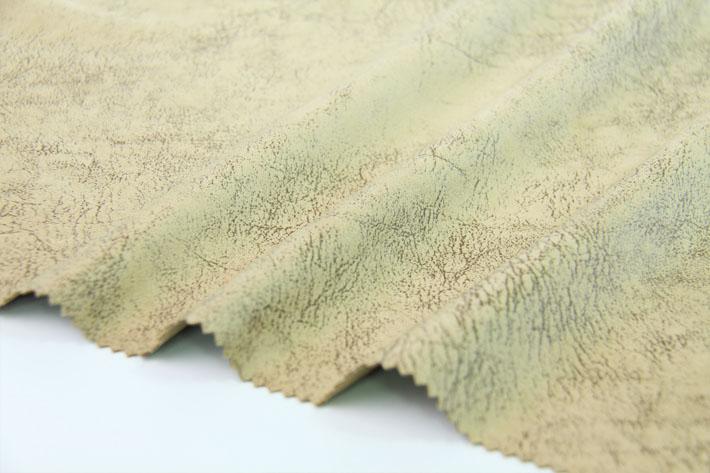 220克烫金针织麂皮绒,花型细节,仿动物皮纹纹理。